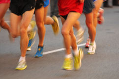 Marathon runners legs. On the road followed by another runner with panning blur Royalty Free Stock Photo