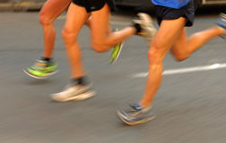 Marathon runners legs Royalty Free Stock Images