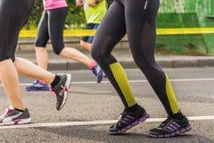 Marathon runners legs stock images