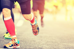 Marathon runners legs running Stock Image