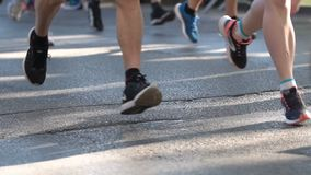 Marathon runners legs only. Slow motion. Marathon running race. Legs and bodies only. Unrecognizable people. The marathon is a long-distance running race with stock video