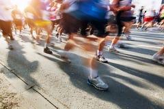 Marathon runners in motion. Running Royalty Free Stock Photos