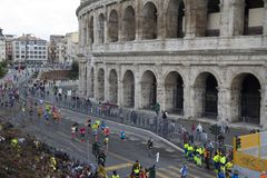 Marathon runners near the finish line in Colosseum stadium of Rome, Italy royalty free stock photo