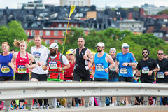 Marathon runners over the famous Vasterbron bridge with a pacer Royalty Free Stock Image
