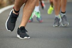 Marathon runners race. On the asphalt road Royalty Free Stock Image