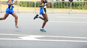 Marathon runners running on city Royalty Free Stock Photo
