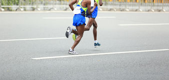 Marathon runners running on city Stock Image