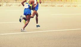 Marathon runners running on city Stock Images