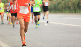 Marathon runners running on city road Royalty Free Stock Photo