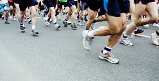Marathon runners running on city street Royalty Free Stock Image