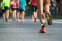Marathon runners. Marathon running race, people feet on city road Royalty Free Stock Photo