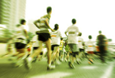 Marathon runners running on the street Royalty Free Stock Photo