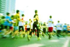 Marathon runners running on the street Stock Photo
