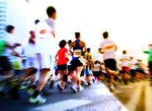 Marathon runners running on the street Royalty Free Stock Image