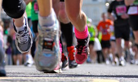 Marathon runners shoes closeup. Marathon runners in sneakers with laces viewed closeup with selective focus Stock Photos