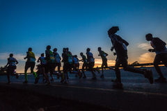 Marathon Runners Silhouetted Colors Stock Photography