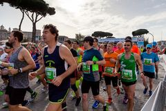 Marathon runners at the start of the race. Rome, Italy - 8 April 2018: Athletes at the start of the 24th edition of the Rome Marathon and Run for Fun, in via Royalty Free Stock Photo