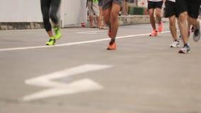 Marathon runners on the street at BITEC half marathon stock footage