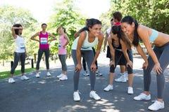 Marathon runners taking a break Stock Photo