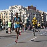 Marathon Runners. VALENCIA, SPAIN - NOVEMBER 16, 2014: Female marathoner Halima Hussen Kayo of Ethiopia competing in the 2014 Valencia Marathon. Kayo finished in Royalty Free Stock Image