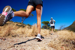 Marathon training. Marathon running athletes couple training on trail fitness sport active lifestyle Royalty Free Stock Photography