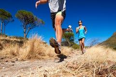 Marathon training. Marathon running athletes couple training on trail fitness sport active lifestyle stock photo
