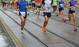 Marathon running. Blurred Motion Marathon running race in city streets Stock Photos