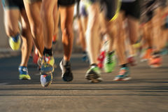 Marathon running. In the light of evening,abstract royalty free stock image