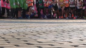 Marathon runners legs only. Slow motion. Marathon running race. Legs and bodies only. Unrecognizable people. The marathon is a long-distance running race with an stock video