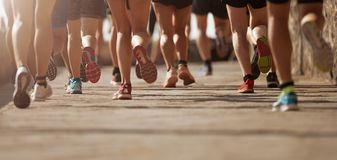 Marathon running race. In the light of evening royalty free stock image