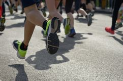 Marathon running race, many runners feet on road racing, sport competition Royalty Free Stock Images
