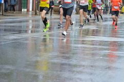 Marathon running race, many runners feet on road racing, sport competition, fitness and healthy lifestyle royalty free stock photos