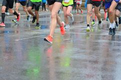 Marathon running race, many runners feet on road racing, sport competition, fitness and healthy lifestyle royalty free stock photo