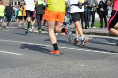 Marathon running race, many runners feet on road, sport, fitness and healthy lifestyle Stock Photos