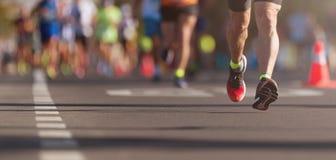Marathon running race. People feet on city road royalty free stock photo