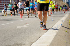 Marathon running race, people feet on road, sport concept Stock Image