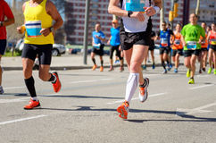 Marathon running race, people feet on road, sport concept Stock Images