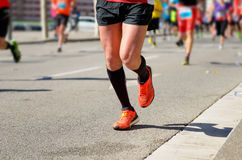 Marathon running race, people feet on road, sport concept Royalty Free Stock Photography