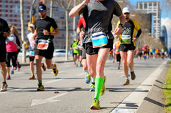 Marathon running race, people feet on road, sport concept Stock Photography