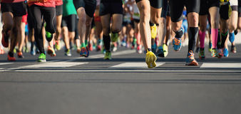Marathon running race, runners feet on road. Marathon running in the light of evening stock photo