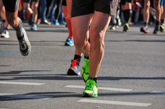 Marathon running race, runners feet on road, sport, fitness concept Royalty Free Stock Photos
