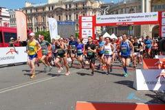 Marathon, starting line. Run competition. Men and women running. Starting gate. ODESSA, UKRAINE - 25 JUN 2017: Marathon, starting line. Run competition. Men and Stock Photo