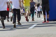 Marathon, street runners in spring day. Ukraine, Kiev, Intersport Ukraine 10.09.2017 Marathon running race, people feet on road, sport, fitness and healthy Royalty Free Stock Images
