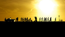 Marathon at sunset. Marathon runners silhouettes at sunset at the island of Ameland, The Netherlands Stock Photography