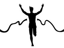 Marathon winner. Silhouette of a man running thru the finish line Stock Image