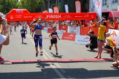 Free Marathon With Children. Kid Runners At Finish Line At Summer Maraton Royalty Free Stock Image - 106510116