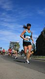 Marathon - Woman from low angl Royalty Free Stock Photos