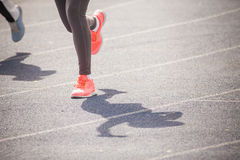 Marathon of womens feet jogging outdoor by the road Stock Image