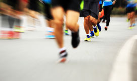 Marathonatleten het lopen stock foto's
