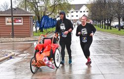 Marathoners running in cold rainy wet conditions,
